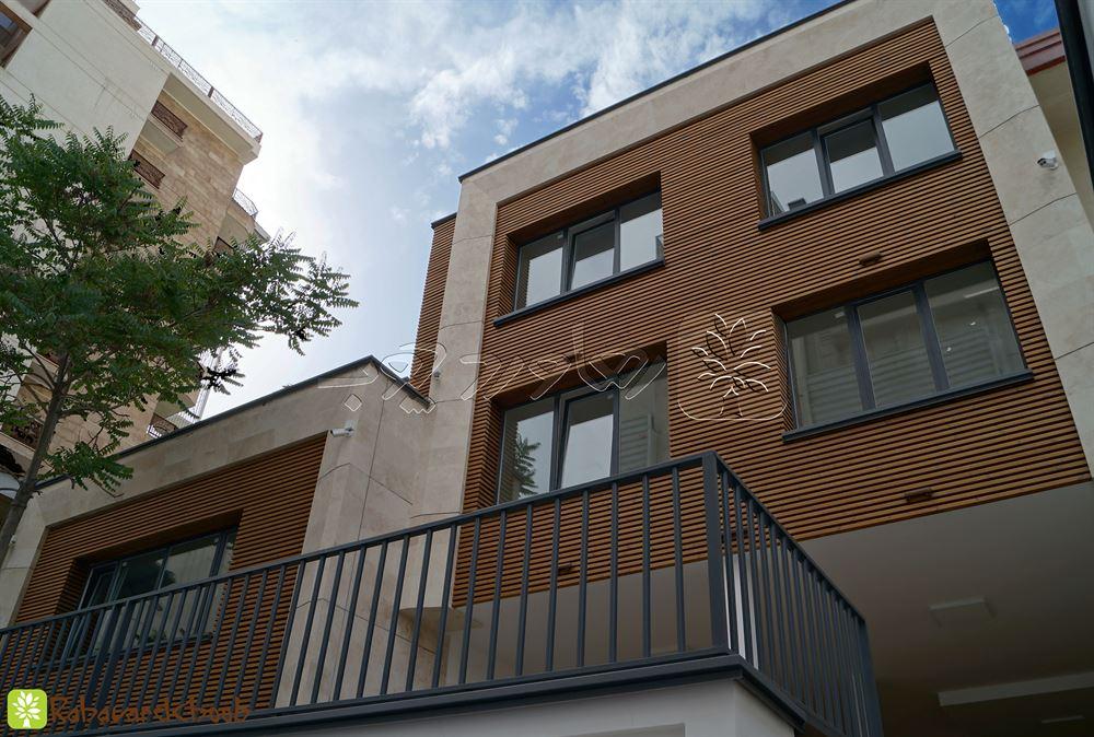 نصب چوب ترمو در نمای ساختمان در ولنجک